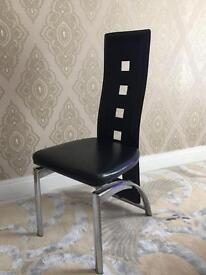 6 Black Leather Chairs with glass table , excellent condition to collect £140 ono