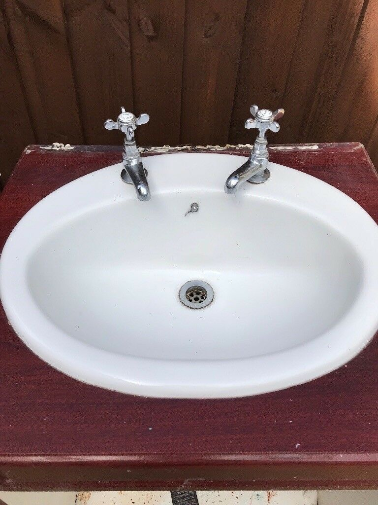 Bathroom sink with taps free