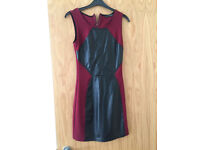 Deep red and leather going out dress, short, very stylish. Size 6-8.