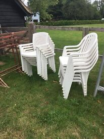 12 white plastic stackable chairs