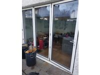 Bi fold doors with fitted blinds