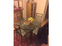 Dining table and chairs and glass cabinet for Quick sale
