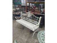 Long cream coloured garden bench