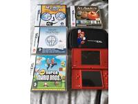 Nintendo DSI red with 4 games and carry case