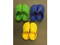 3 pairs of Crocs in assorted colours - size M8/W10