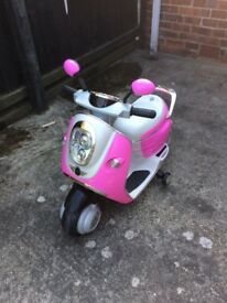 Child's powered scooter with working lights and indicators