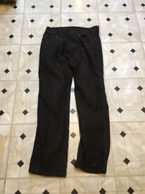 Nearly new black armoured jeans