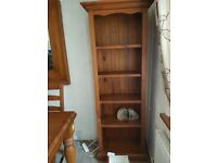 Solid pine dining table with four chairs. Large matching mirror and two bookcases