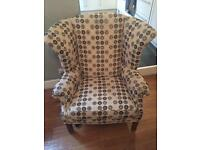 Wing backed armchair