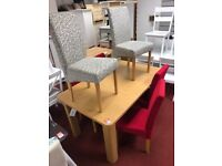 Extendable dining table and 6 fabric chairs