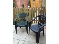 Two plastic garden chairs