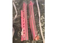 2 pink clothes rail with zipped cover