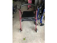 4 wheeled walker with a seat
