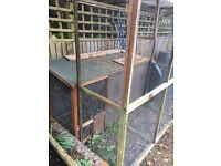 Large rabbit hutch, on 2 levels with square run would suit 2 rabbits
