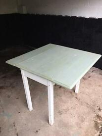 Painted outdoor extendable table