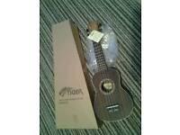 Theodore rosewood ukulele unused in original box