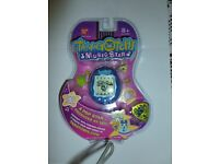 Tamagotchi Music Star Version 6 Rock City - NEW unopened packaging