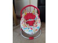 Baby bouncer with vibration and sounds