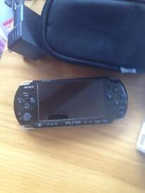 Sony PSP 3003 with 15 games, 2 movies, carry case, charger and 4GB card