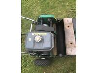 Petrol lawn mower with roll