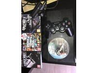 500GB Super Slim PS3 with Camera + 4 Games