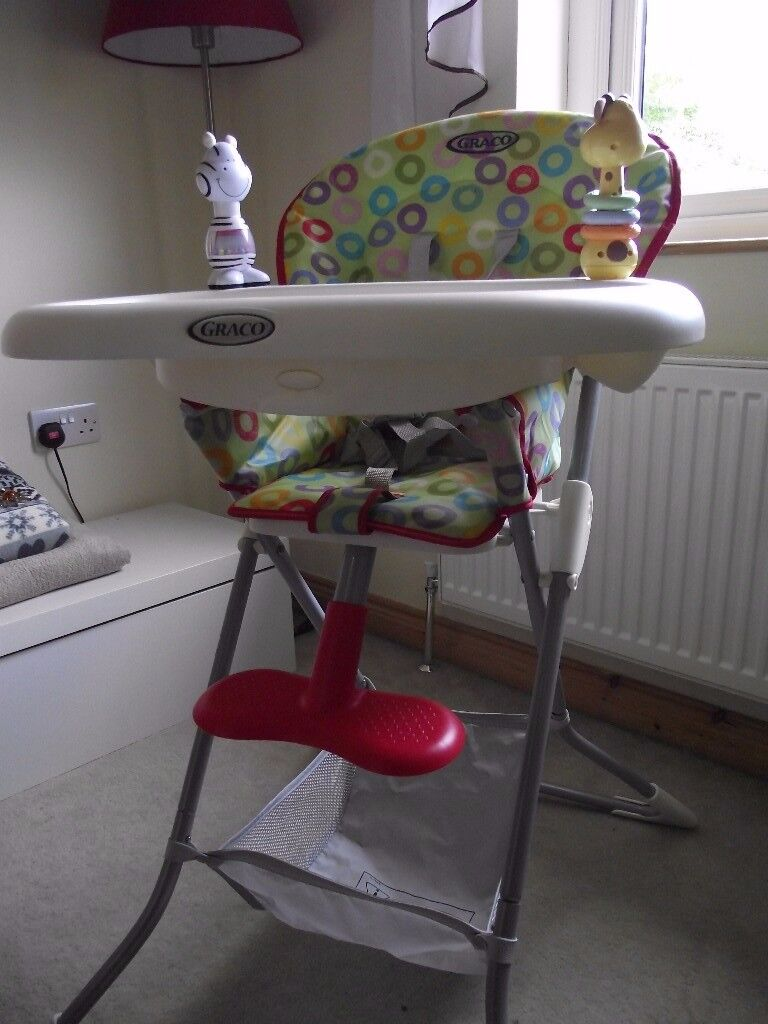 For quick sale Graco foldable high chair with storage net.