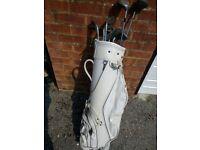 set of golf clubs plus bag