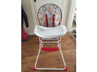Baby's red and white high chair - clean high chair from pet free and smoke free home.
