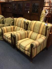 2 large high back armchairs