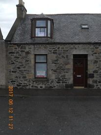 Terraced property with rear garden for sale in Banff. Close to the hospital and health centre