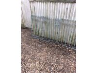 Metal wrought iron gates ,a pair ,size is approx 3 foot by 8 foot wide with locking bolt