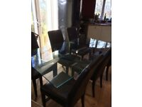 Glass dining table. £100. 6 leather chairs perfect condition £60.
