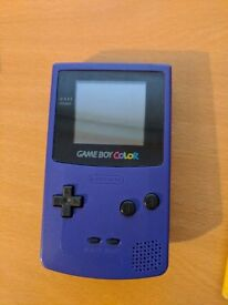 Gameboy colour purple with 32 games in 1
