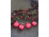 Red and green tinsel red baubles