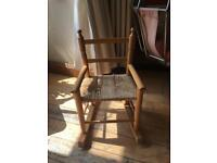 A LOVELY CHILDS ROCKING CHAIR IN PINE WITH RUSH SEAT