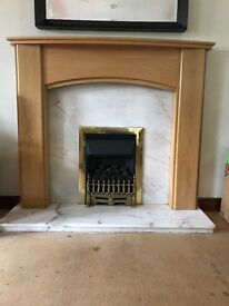 Solid wood surround and stone inset fireplace