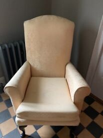 Two wing back style chairs