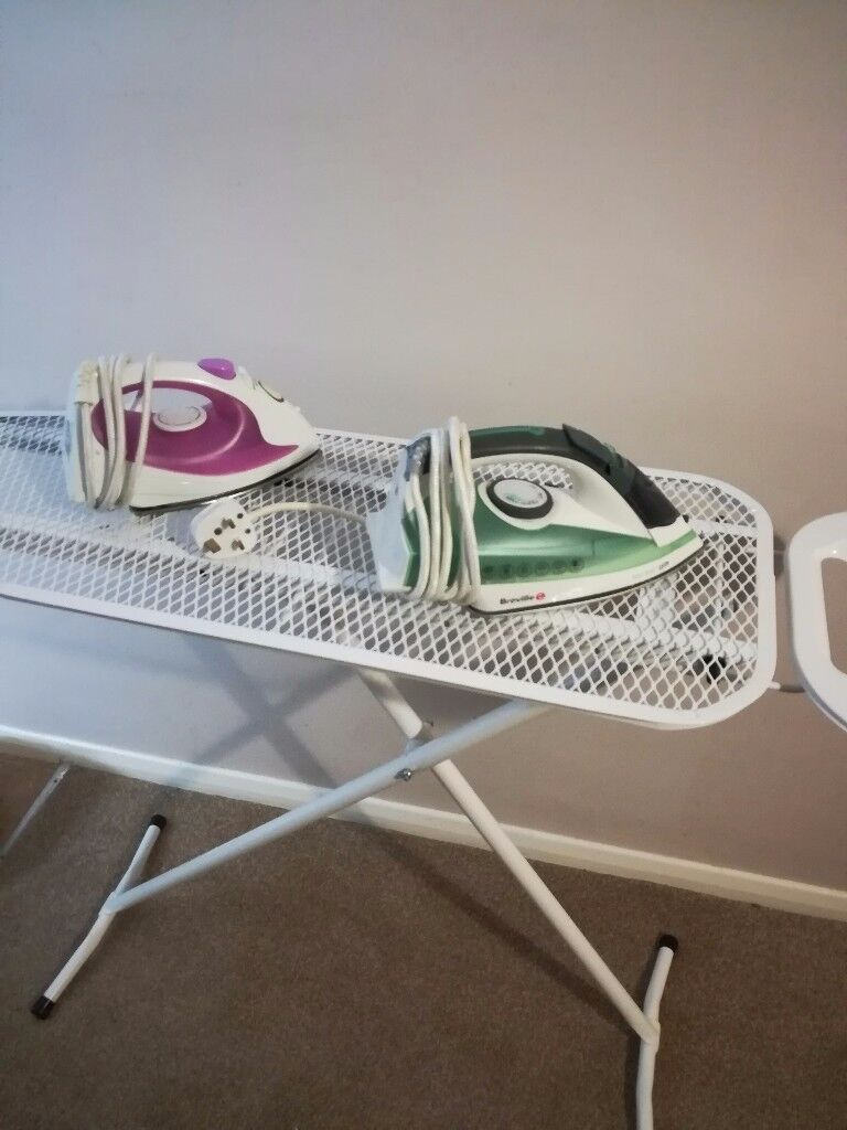 Ironing board and 2 irons.