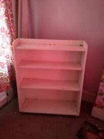 Bookcase white painted wooden on wheels