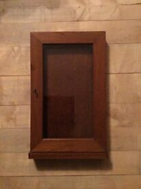 Collectors cabinet with key and glazed door