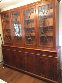 Display cabinet. Stunning four door display cabinet in yew wood. Great for display and storage