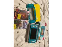 Nintendo switch lite in teal/turquoise with mine craft & dungeons unopened games! 64GB Zelda SD card