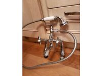 Chrome mixer tap with hand hrld shower