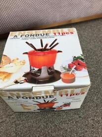 Cast iron Ensemble fondue set unwanted gift