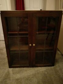 Wooden, glass fronted cabinet.