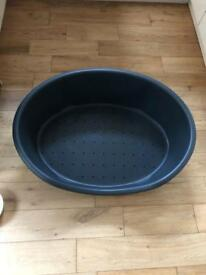 Large grey dog bed/ basket. Near enough brand new.