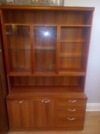 Retro teak wall display unit with cupboards.