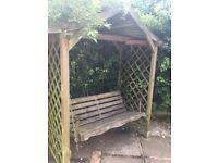 Wooden swinging garden chair