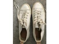 Well worn ladies trainers