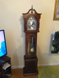 Chiming graddaughter clock imaculate condition